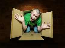 The man tries to escape from the close box Stock Photos
