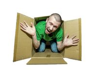 A man tries to escape from the cramped box. Isolated on white background royalty free stock photography