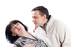 Man tries to kiss a woman Stock Images