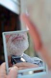 Man trim his beard Royalty Free Stock Images