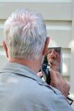 Man trim his beard Royalty Free Stock Photography