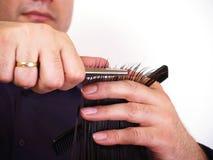 Man trim woman hairs Royalty Free Stock Photo