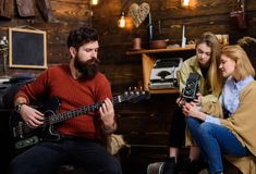 Man with trimmed beard playing electrical guitar. Rock musician spending time with family in countryside. Bearded man. Man with trimmed beard playing electrical royalty free stock photography