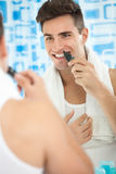 Man with trimmer near his nose Royalty Free Stock Photos