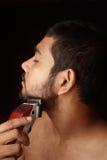 Man trimming beard Royalty Free Stock Photos
