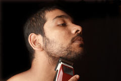 Man trimming beard Stock Photo