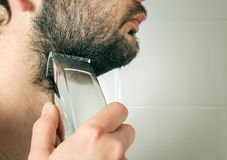 Man trimming beard hair Stock Images