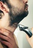 Man trimming beard hair closeup Stock Photos
