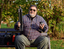 Man with tripod and ball-head Stock Photography