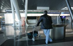 Man and trolley. Waiting in the airport Royalty Free Stock Photos