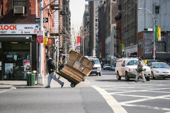 Man with trolley in New York Stock Image