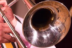 A man on a trombone plays jazz or other music. Close-up Stock Photos