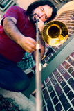 Man trombonist plays Royalty Free Stock Images