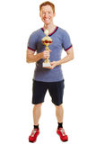 Man with a trophy as a winner. In a sport competition Royalty Free Stock Photo