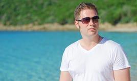 Man on tropical beach. Stock Photography