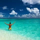 Man at tropical beach Stock Photography