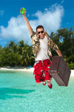 Man in a tropical island. A young, attractive male in a colorful outfit in a tropical island setting as a stereotype tourist stock photo