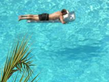 Man on tropical pool Stock Image