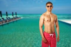 Man at tropical swimming pool Royalty Free Stock Photo