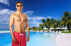 Man at tropical swimming pool Stock Images