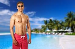 Man at tropical swimming pool Stock Images