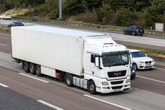 MAN truck with a trailer on German highway Stock Photo