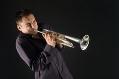 Man trumpet. Man in shirt trumpet with might and main. Front view Stock Images