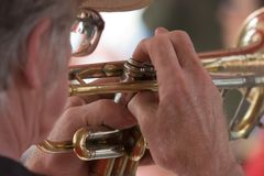 Man on Trumpet_7706-1S. Man Playing Trumpet at Fair Royalty Free Stock Photography