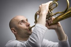 Man with a trumpet. Young man playing the trumpet Royalty Free Stock Photography