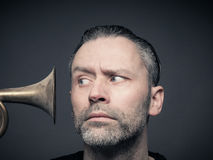 Man with trumpet Stock Images