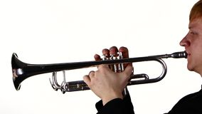 Man trumpeter blows the motif in a wind instrument stock footage