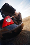 Man in trunk of car Stock Image