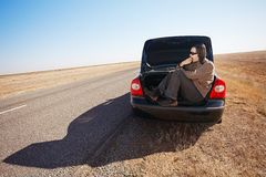 Man in trunk of car Stock Images