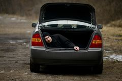 Man in the trunk Stock Photo