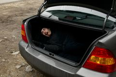 Man in the trunk Royalty Free Stock Photos