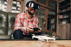 Man try to control drone in vr glasses Stock Photo