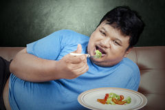 Man try to diet by eating vegetable Stock Photos