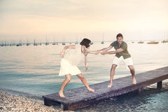 Man try to push her woman in the water. Man try to push her women in the water in the lake Royalty Free Stock Photo