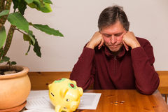 Man try to smash piggy bank Stock Photo
