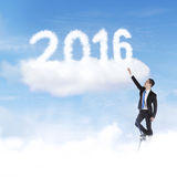 Man try to take numbers 2016 on the sky Stock Images