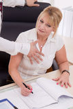 Man try to touch businesswoman at work - concept for bullying. Royalty Free Stock Photography