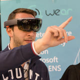 Man trying augmented reality at Technology Hub Stock Photo