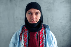 Man trying on a balaklava at the clothing store Royalty Free Stock Photos
