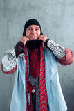 Man trying on a balaklava at the clothing store Royalty Free Stock Image