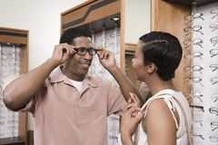 Man Trying Different Eye Glasses Royalty Free Stock Photo