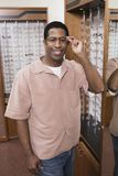 Man Trying Different Eye Glasses At Optometrists Royalty Free Stock Image