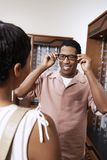 Man Trying On Glasses At Shop Royalty Free Stock Photo