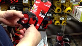 Man trying a new 16 FT tape measure stock footage