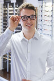 Man Trying On New Glasses At Opticians Stock Photography