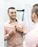 Man trying on new shirt Stock Image